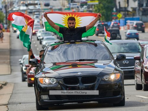 A crowd of over 500 people protest in support of Kurds after the Trump administration changed its policy in Syria